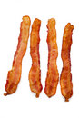 Slices of bacon on white Royalty Free Stock Photo