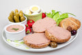 Slices of bread with home made pate vegetables and eggs plate Royalty Free Stock Photos
