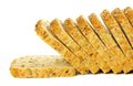 Slices of bread toppling a loaf over a white background Stock Images