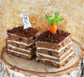 Slices of carrot cake on a stump two delicious with funny rabbit Royalty Free Stock Photo