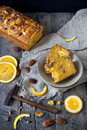 Slices of citrus cake on plate on table with pecan walnuts and orange slices little hammer Stock Images