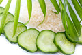 Slices of cucumber with sea salt isolated on white