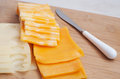 Slices of different kinds of cheese Royalty Free Stock Image