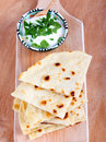 Slices of flatbread on board Stock Images
