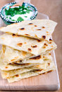 Slices of flatbread on board Royalty Free Stock Image