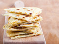 Slices of flatbread on board Stock Photo