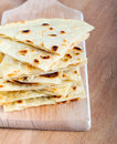 Slices of flatbread on board Royalty Free Stock Images