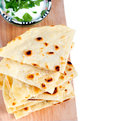 Slices of flatbread on white background Stock Photo