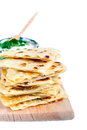 Slices of flatbread on white background Royalty Free Stock Photos