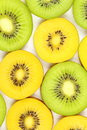 Slices of fresh green and yellow kiwi fruits food background texture Royalty Free Stock Photo