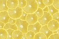 A slices of fresh yellow lemon texture background