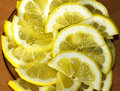 A slices of fresh yellow lemon texture background pattern.