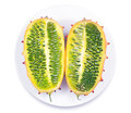 Slices of fruit kiwano tropical on a white plate Stock Photo