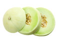 Slices of honeydew melon on white background Royalty Free Stock Image