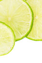 Slices of lime fruit vii over white background Royalty Free Stock Photography