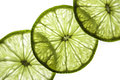 Slices of lime a on illuminated white background Stock Photo