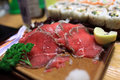 Slices of marinated beef on the plate gyuniku tataki in the japanese restaurant Royalty Free Stock Photo