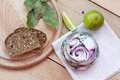 Slices of marinated mackerel with onion in a jar, lime, laurel and bread Royalty Free Stock Photo