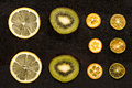 Slices of oranges, lemon and kiwi Royalty Free Stock Photo