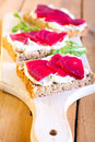 Slices ot of bread with herb creamcheese and sliced beetroot Royalty Free Stock Photography
