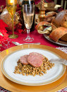 Slices of pig trotter with lentils over christmas table Royalty Free Stock Images