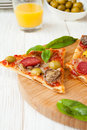 Slices of pizza with salami and basil food Royalty Free Stock Image