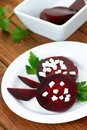 Slices of red beet with goat cheese Royalty Free Stock Photos