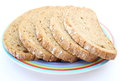 Slices of rye bread and colorful plate Royalty Free Stock Photo