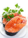 Slices of salmon on a white background Royalty Free Stock Images