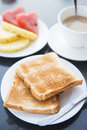 Slices of toast bread on white dish Royalty Free Stock Photo