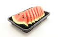 Slices of watermelon in black tray on white background Royalty Free Stock Photo