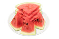 Slices of watermelon on plate with white background Stock Images