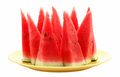 Slices of watermelon on yellow plate isolated on white backgroun Royalty Free Stock Photo