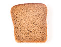 Slices of wholemeal bread over white background Royalty Free Stock Images