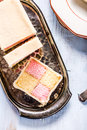 Slicing Battenberg homemade sponge cake Royalty Free Stock Photo