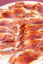Slicing jamon on a white plate Stock Images