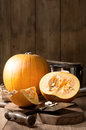 Slicing pumpkins cutting for soup in rustic kitchen Royalty Free Stock Photos