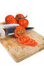 Slicing tomato chopping on kitchen board Stock Photo