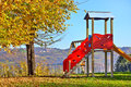 Slide on empty playground lone children s in autumn in small town of diano d alba italy Stock Photos