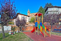 Slide on empty playground lone children s in autumn in small town of monticello d alba italy Royalty Free Stock Image