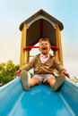 Slide happy little boy having fun sliding at playground Stock Photography
