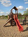 stock image of  Children´s red slide in a playground