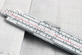Slide rule on chart paper Royalty Free Stock Photos
