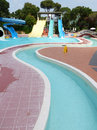 Slide in water park colorful tubes and pool tropical aquapark Stock Photo