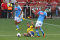 Sliding tackle in the emirates cup on gokhan inler during match arsenal napoli for played london on rd of august Stock Photography