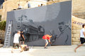 Sliema street art festival malta june mr dheo portugal and sofles australia two well known graffiti artists painting together at Stock Photo