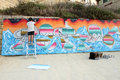 Sliema street art festival malta june pariz one graffiti artist from portugal painting at the beach during the on june in Stock Image