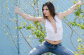 Slim athletic woman standing against fencing wire Royalty Free Stock Photo