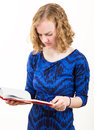 Slim blonde woman reading a book on white background Royalty Free Stock Photography