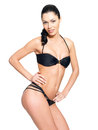 Slim body of young  woman in black bikini Royalty Free Stock Image